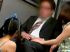 Two naughty girls suck some sleeping guy's dick in a public bus
