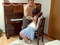 Hot Asian chick gets her pussy drilled hard near a piano