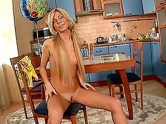 Hot blonde Ariel puts a huge toy in her wet pussy