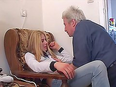 A beautiful blonde babe gives a blowjob to an old dude