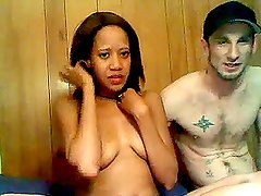 Tattooed guy fucks a gorgeous ebony babe in a sauna