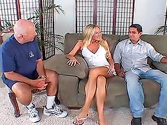 Sexy blonde gets her holes drilled in the presense of two voyeurs
