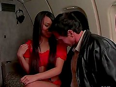 Lucy Thai sucks and rides Peter North's cock in the plane