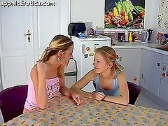Two nasty lesbians fucking each other on the dinner table
