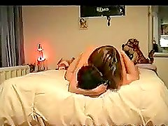 A horny couple having sex in missionary position on the bed