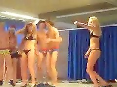 A few sexy girls take their clothes off at a frat show