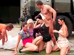 Pissing and fucking orgy outdoors