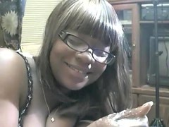 Chubby ebony with glasses sucking cock for jizz