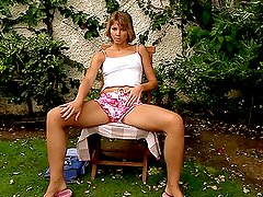 Hot blonde babe fucks herself hard in the backyard