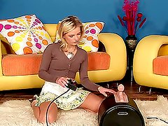 A hot blonde is taking a ride on a fucking machine