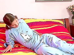 Nasty brown-haired teen playing with a dildo on her bed