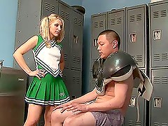 Blonde cheerleader Ashley Fires gives a footjob in the locker room