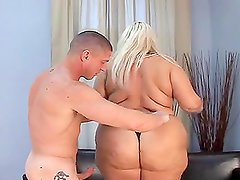 Fat blonde Mellanie Gold takes a dick in her fleshy pussy