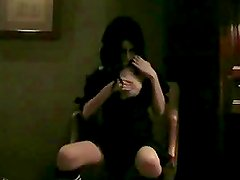 Watch this salacious slut messing with her clit and tits