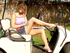 A hot sexy blonde bitch plays with dildo in a golf cart
