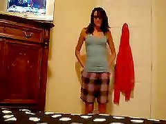 Homemade video of a hot brunette babe performing her sexy show