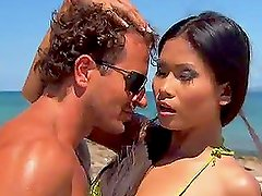 Hot tanned brunette get fucked on the beach