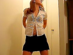 Attractive chick dancing striptease for the webcam
