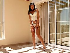 A sexy brunette bitch in high heels masturbates on the balcony.