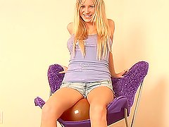 Hot teen girl is having much fun with toy balloons