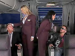 Two stewardesses get fucked by two business class passengers