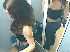 Dressing room hidden cam shoots this sexy brunette babe