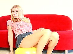 Yellow toy balloon is in between hot blonde babe's legs
