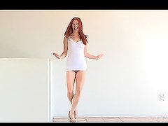 Redhead babe Melody shows her body and stretches out her vulvar lips