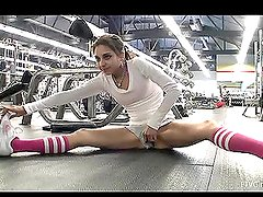 Very pretty Trinity is exercising in the gym in a very sexy way