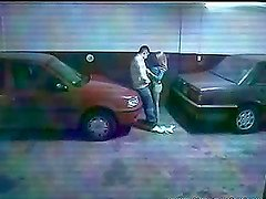 Couple got stucked in between two cars and they start with blowjob