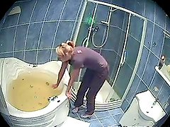 A guy fucks his sexy blonde girlfriend in the bathroom