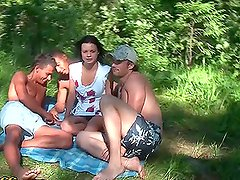 Hot brunette babe fuck with three guys at the picnic