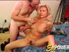 She jacks him off as he fondles her body