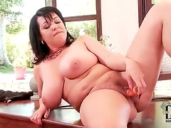 Chubby chick with a dildo has some fun