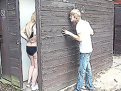 A mature woman gets fucked by a young guy behind the shed