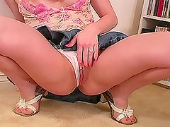 Horny blond in tiny skirt goes for a handjob to get pinned.
