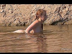 Hot tempting video of busty Felicia swimming in laguna naked