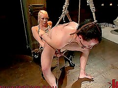 Ball Torture in Femdom Action Vid with Blonde Girl on Leather Boots