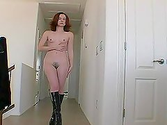 Girl in Long Leather Boots Taking Off Her Clothes in Sexy Stirptease
