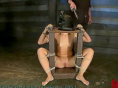 Short Haired Blonde Tied To a Table in the Dungeon