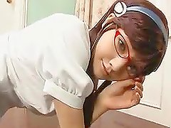 Cute Asian School Girl on Glasses Crawling on the Floor