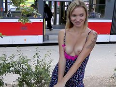 Adorable girl shows her privates in a public place at the day time