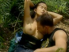 Nice looking babe with peachy tits gets fucked in the forest