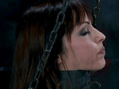 Sexy bosomy babe Emily Marilyn locked in cage in BDSM sex video