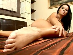 Brunette Panthera Nicoll in golden lingerie stripteases on the bed