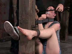 Wearing slave hood Bronte gets tied with ropes in the shed