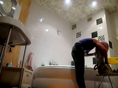 A hidden cam in the bath catches Ashley taking shower