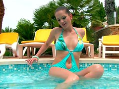 Magnetizing babe Sandra Shine is posing on a cam in a sexy swimsuit