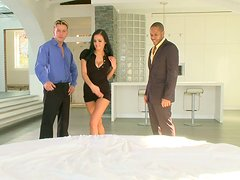 Horny darkhead Candy Alexa lies on a bed seducing two guys and later fucks them both