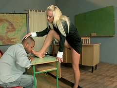 Slutty teacher Carla Cox blows big black dick of her student
